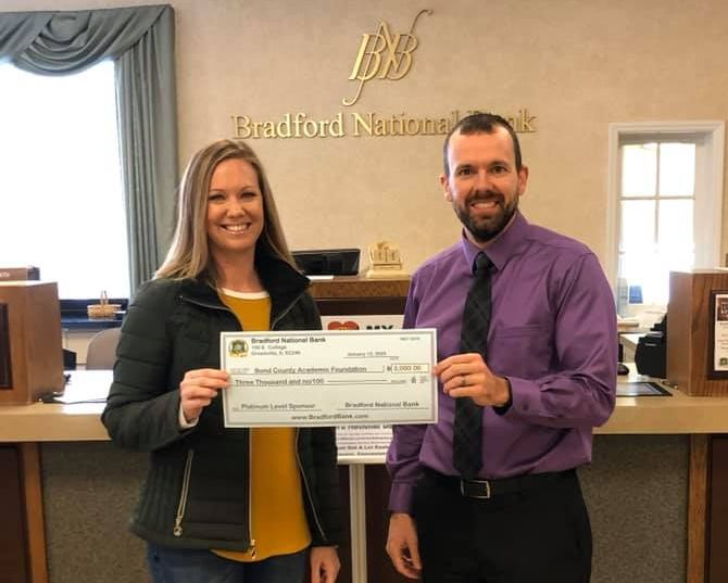 President Mike Ennen presented Bond County Academic Foundation Gala Chair Rachel Wayman with Bradford National Bank's Double Platinum Sponsorship check for 2020's gala.