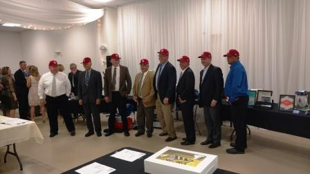Cardinals ball caps auction bidders. Only one would win Cardinals tickets!
