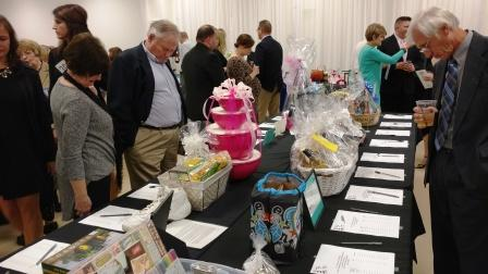 Attendees shop the silent auction items