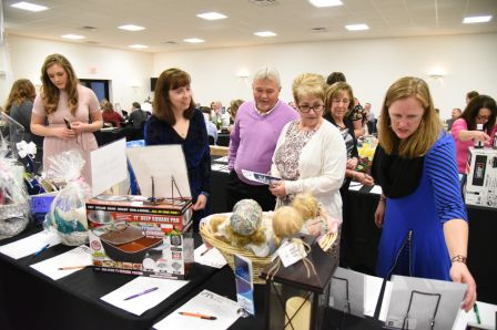 Attendees shop the 2018 silent auction items